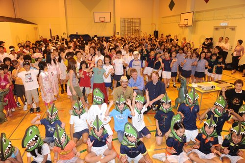 Let's roar together!   June 11, 2010, Hong Kong -- 300 primary students from Chinese International School and Quarry Bay School gathered at the CIS school gym today to get ready for face-to-face encounter with Baby T-Rex.